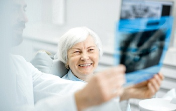 happy patient talking to dentist