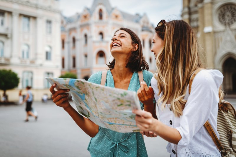 two girls laughing while traveling